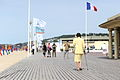 Old woman walking on Les Planches de Deauville.jpg
