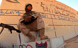 Marine Air Support Squadron 3 - IRAQ – Lance Cpl. John A. Marcogliese of MASS-3 stands guard at one of several Olympic stadiums in Baghdad during the 2003 invasion of Iraq.