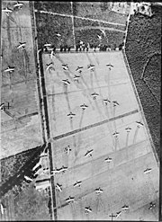 Aerial view of fields covered in abandoned gliders