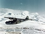 PBY-5A Catalina on a patrol flight over a snow-covered Aleutians Island c1943.jpg