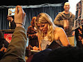 PaleyFest 2011 - Freaks and Geeks-Undeclared Reunion - Busy Philipps signs for fans (5524465229).jpg