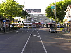 Papanui Junction with the 99-year-old Papanui Building centred. Taken from Papanui Road with the Main North Road leading away to the right and Harewood Road leading away to the left. (2008)