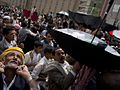 Passing cash forward - Flickr - Al Jazeera English.jpg