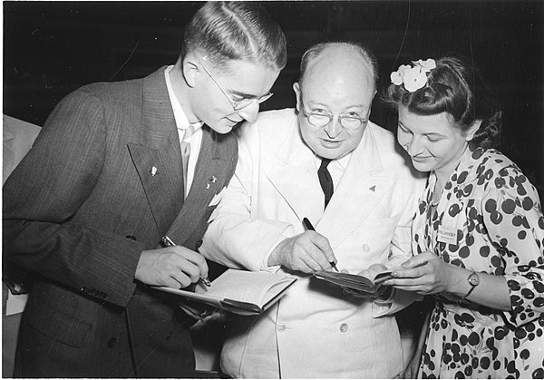 Davis (center) with two young scientists in 1924 Paul E. Teschan (1923- ), Watson Davis (1896-1967), and Marina Prajmovsky (1924-1974), 1942 (4405669463).jpg
