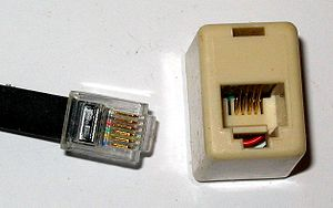 Telephone plug - A modular connector plug (6P6C) and socket (6P4C).