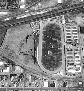 Playfair Race Course - Aerial view of the facility in 1995 showing grandstand, barns, and parking lot.