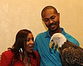 Posing for picture with Bald Eagle. (10595330023).jpg