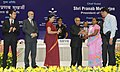 Pranab Mukherjee gave away the Saakshar Bharat awards at the International Literacy Day celebrations, in New Delhi. The Union Minister for Human Resource Development, Smt. Smriti Irani and the Secretary (3).jpg