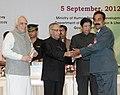 Pranab Mukherjee presenting the National Award for Teacher-2011 to Shri Arun Kumar Mishra, Madhya Pradesh, on the occasion of the 'Teachers Day'.jpg