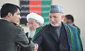 President Hamid Karzai congratulates a graduate from the National Military Academy Afghanistan (4443054076).jpg