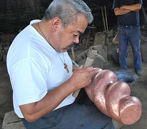 Metalsmith - Coppersmith Abdón Punzo in his workshop in Santa Clara del Cobre, Mexico
