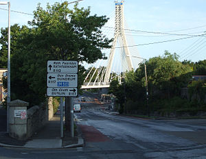 R112 road (Ireland) - R112 looking west to crossroads at Dundrum and the Luas Dargan Bridge.