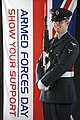 RAF Serviceman With the Armed Forces Day Flag MOD 45152782.jpg