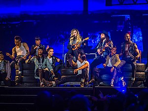 "True Blue (Madonna song) - Madonna, flanked by all of her dancers, performs an acoustic version of ""True Blue"" as part of the Rebel Heart Tour."