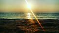 Rishehr sun rise beach.png