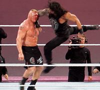 Reigns executing his Superman punch on Brock Lesnar at WrestleMania 31
