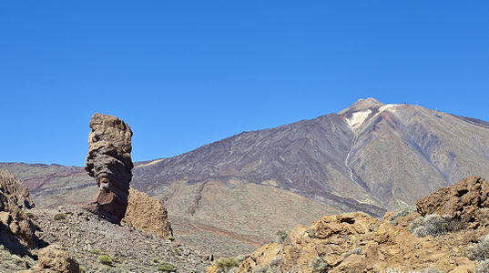 Roque Cinchado (volcanic plug on the left) with the Teide (highest summit in Spain) in the background, Teide National Park, Tenerife, Spain