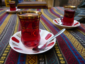 English: Rose Hip Tea in a Turkish glass Franç...