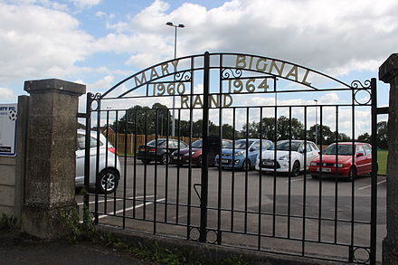 The gates of Rowdens Road Cricket Ground dedicated to Mary Bignal-Rand Rowdens Road Cricket Ground, Wells gates.JPG