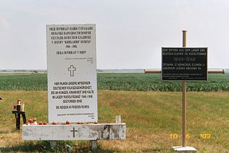 "Knićanin - The memorial at the edge of the old German graveyard, where the internees of the prison camp themselves buried those who died of ""hunger, disease, and cold"", according to the sign."