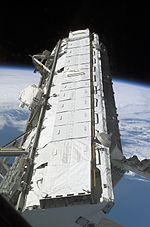 S112 S1 truss is moved from the Payload Bay of Atlantis.jpg