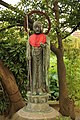STATUE OG HOLY MAN BY TEMPLE BY LOTHUS DAM IN TOKYO.jpg