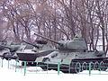 SU-100, PT-76 and T-34-85 in a msuem in Chisinau, Moldova 2.jpg