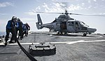 Sailors aboard USS Ross (DDG 71) refuel a French navy helicopter. (34622961961).jpg