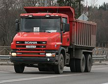Red dump truck on the road