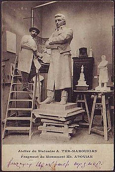 Sculptor AndreasTer-Marukyan in his studio with a sculpture of Khachatur Abovyan (France, 1910).jpg