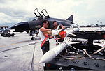 Senior Airman Kevin Stickly, left, and Airman 1st Class Dennis Hall, both 307th Tactical Fighter Training Squadron munitions specialists, prepare AIM-9 Sidewinder missiles during Exercise Solid Shield '87 DF-ST-88-03783.jpg