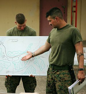 Tactical decision game - Sergeant Daniel Smith, USMC, a squad leader with the Ground Combat Element, Security Cooperation Task Force, Africa Partnership Station 2011, conducts a tactical decision game for his Marines.