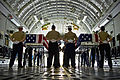 Service members stand at parade rest next to flag-draped transfer cases during an arrival ceremony in honor of fallen U.S. personnel whose identities remain unknown, at Joint Base Pearl Harbor-Hickam on Nov 121130-F-MQ656-113.jpg