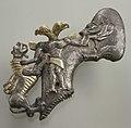 Shaft-hole axe head with bird-headed demon, boar, and dragon MET 1982.5.jpg