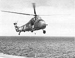 Sikorsky UH-34E of HC-1 in flight over USS Hornet (CVS-12), in the 1960s.jpg