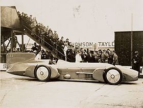 "Sir Malcolm Campbell at the wheel of the ""Bluebird"", with crowd, 1926 - 1936.jpg"