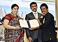 Smriti Irani presenting the Rajat Kamal Award to Jayaraj (Special Mention) for the Non-Feature film – REBIRTH, at the 65th National Film Awards Function, in New Delhi.JPG