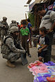 Soldier speaking with a child in Baghdad.jpg