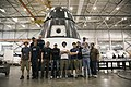 SpaceX engineers around a Dragon qualification unit.jpg