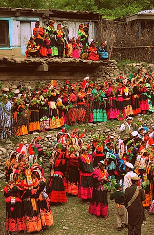 Kalash people - Celebrating Joshi, Kalash women and men dance and sing their way from the dancing ground to the village arena, the Charso, for the end of the day's festivities.