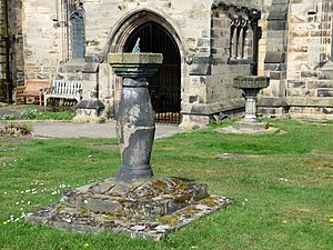 St Cuthbert's Church, Halsall - Sundial and baptismal font in the churchyard.