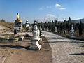Statues in park Lhori.JPG