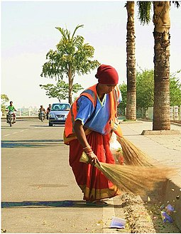 A GHMC sweeper cleaning the Tank Bund Road Street in Hyderabad, India.JPG