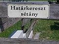 Street sign, Határkereszt Promenade, Biatorbágy, Hungary.jpg