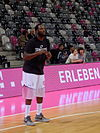 Jimmy McKinney is shooting a 3-pointer for a team in Germany