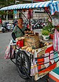 Taipei Taiwan Sweet-Potato-Hawker-with-his-mobile-stall-01.jpg