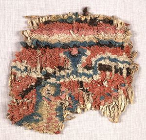 Loulan Kingdom - Fragment of carpet discovered by Aurel Stein in a refuse pit at Loulan. 3rd–4th century.
