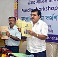 "The ADG, PIB, Kolkata, Shri Debanjan Chakrabarti and the Asstt. Director, All India Radio, Agartala, Shri S.P. Mandal releasing the booklets on compilation of ""Maan Ki Baat.jpg"