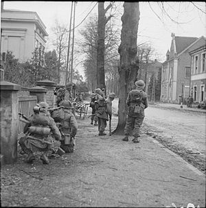 227th Infantry Brigade (United Kingdom) - Infantrymen of the 2nd Battalion, Gordon Highlanders clearing snipers in Kleve, Germany, 11 February 1945.