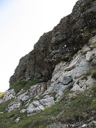 Moine Thrust Belt - The Moine Thrust at Knockan Crag, in the central section of the thrust belt. Neoproterozoic Moine schists are thrust over Cambrian–Ordovician Durness Group dolostones